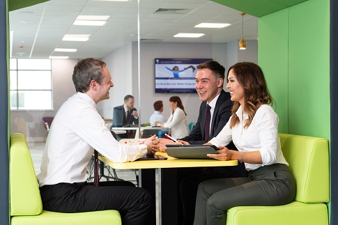 trainee financial adviser receiving tuition from an experienced colleague